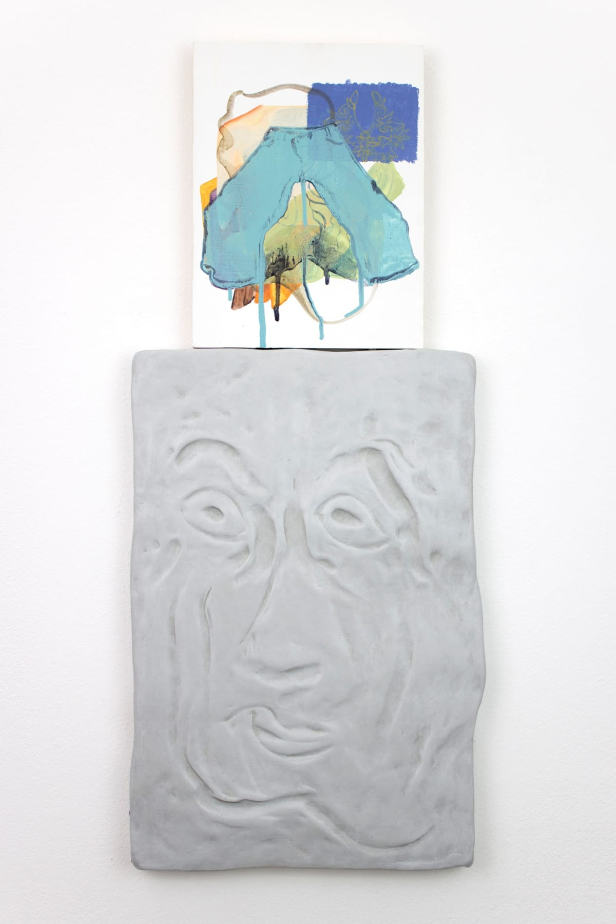 titania seidl lukas thaler, artist, artwork shows a relief of a face with a caricature facial expression ontop of its head is a painting like a thought bubble showing shapes and a pair of lightblue trousers