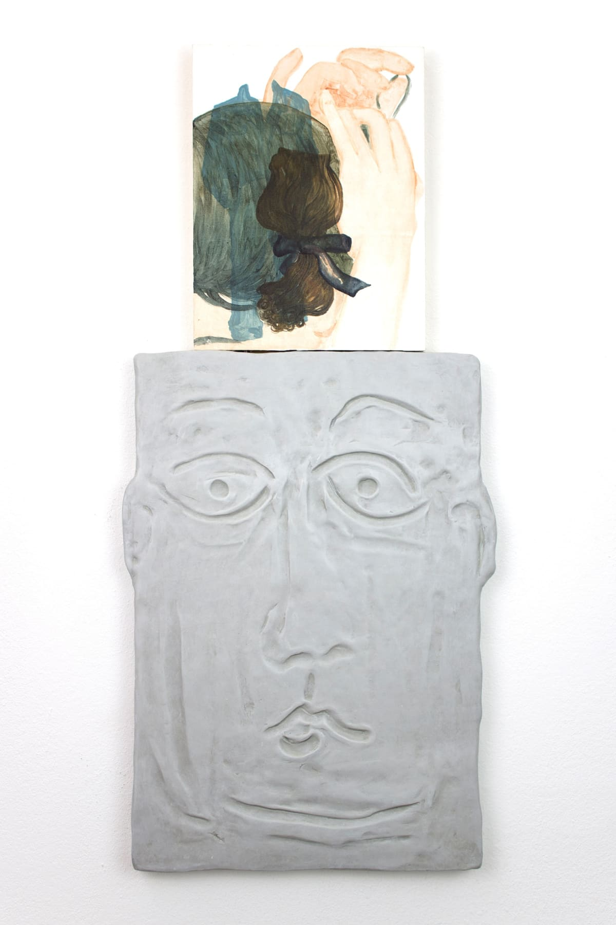 titania seidl, artwork shows a relief of a face with a caricature facial expression ontop of its head is a painting like a thought bubble showing two hands holding a scrunched up scarf