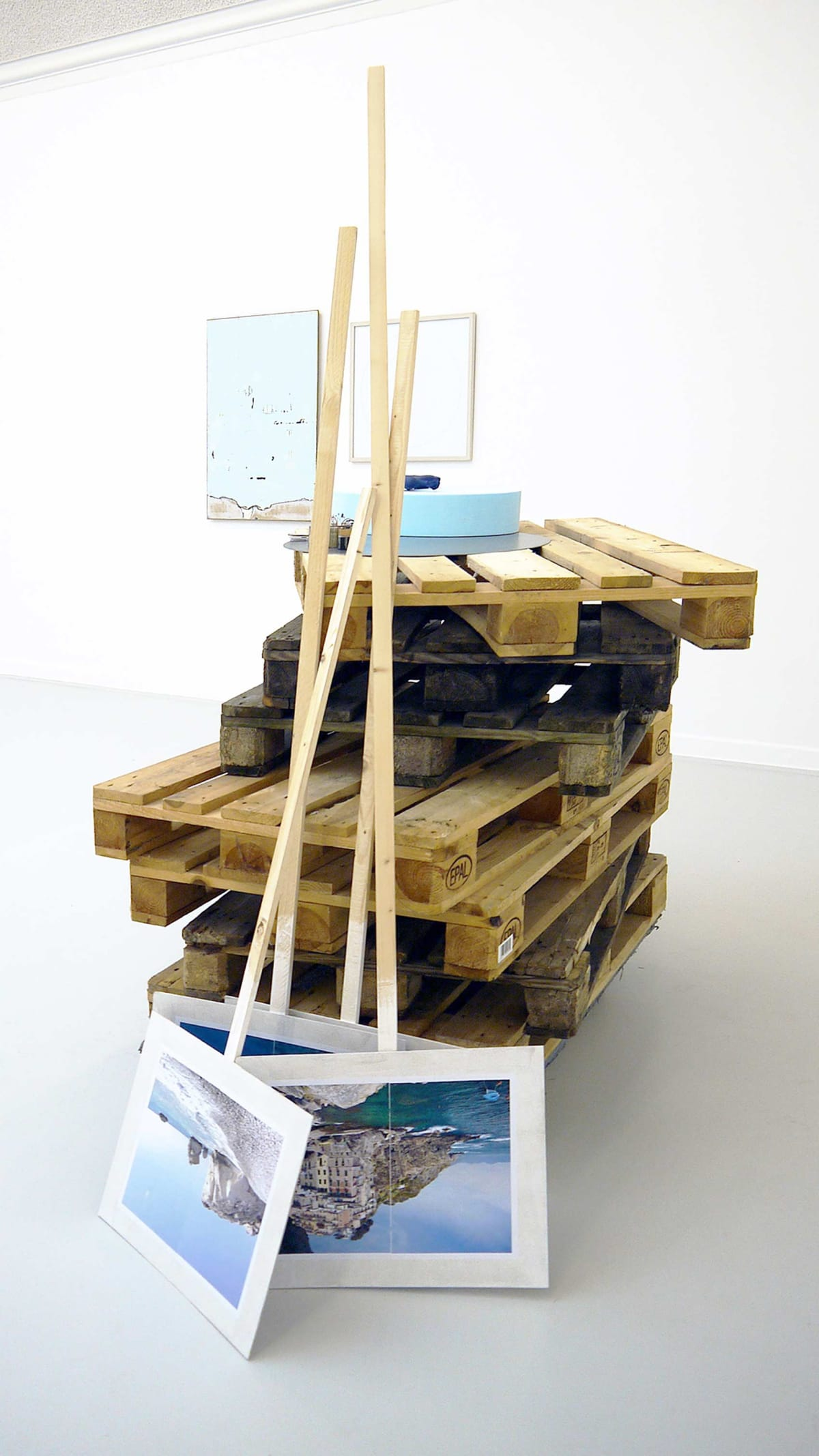 The Kunst Verein Konstanz present the artists Irena Eden & Stijn Lernout the image shows a white room artworks on the floor leaning on stacked palettes