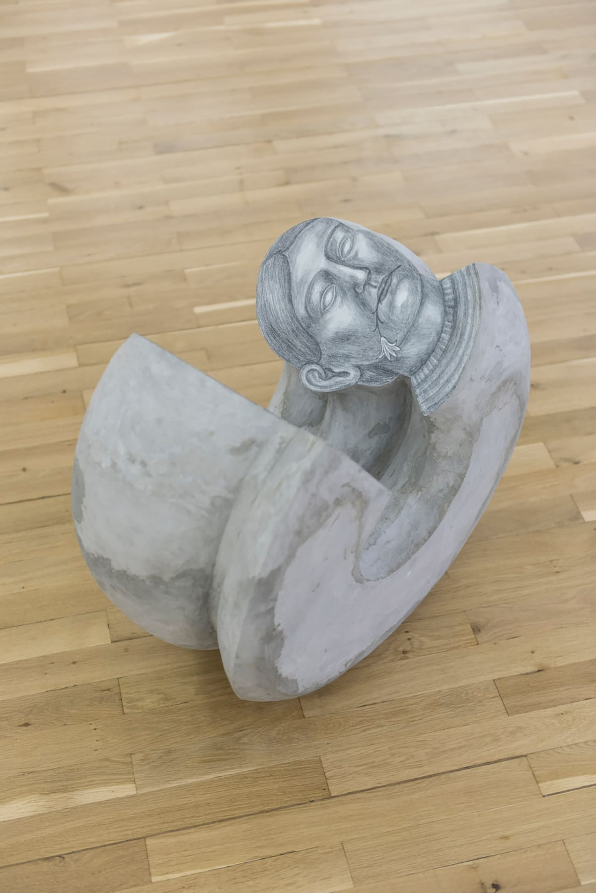 Image shows sculpture of a woman like snail