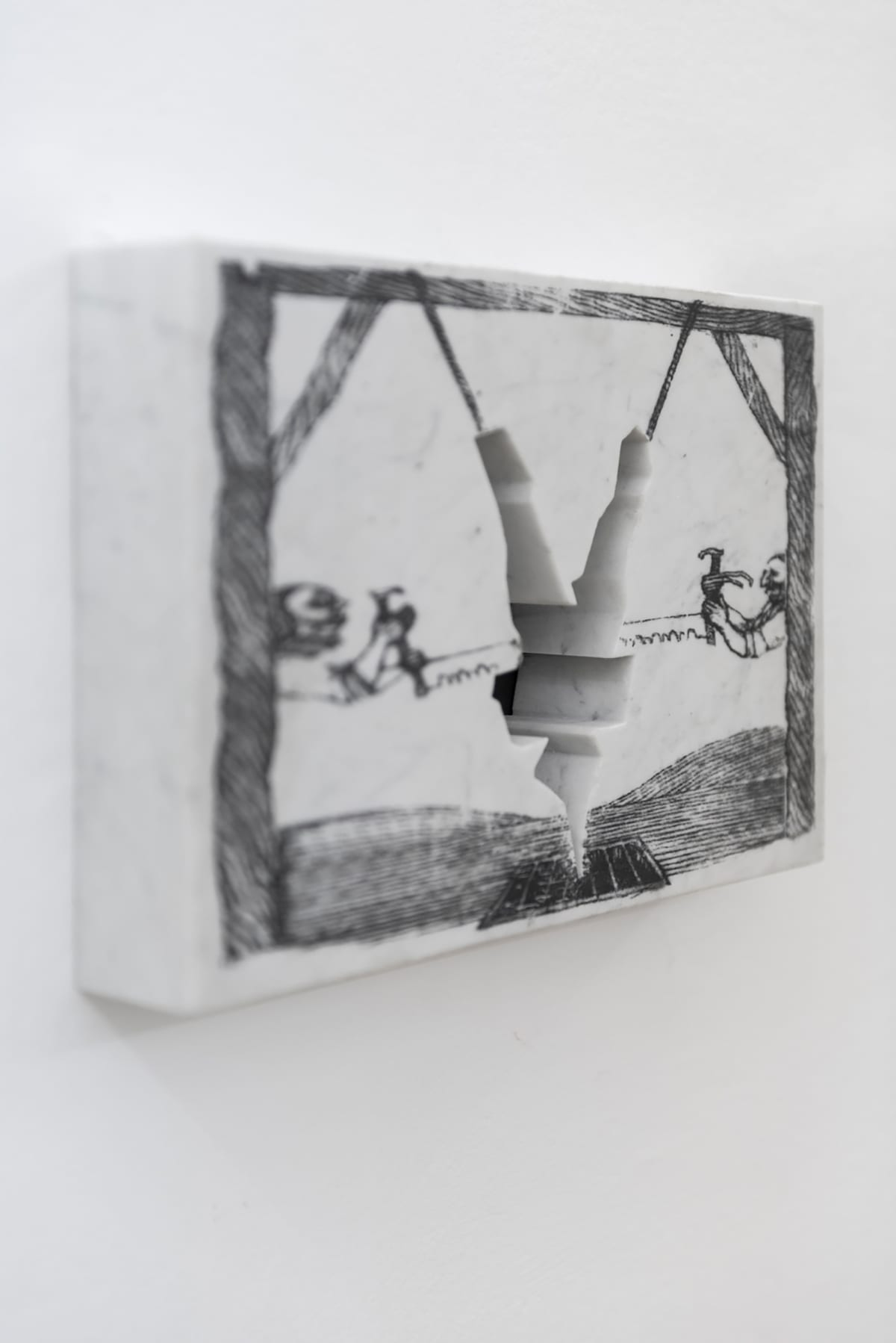 Image shows small artwork marble with a photo transfer and a piece has been cut out in the form of a man