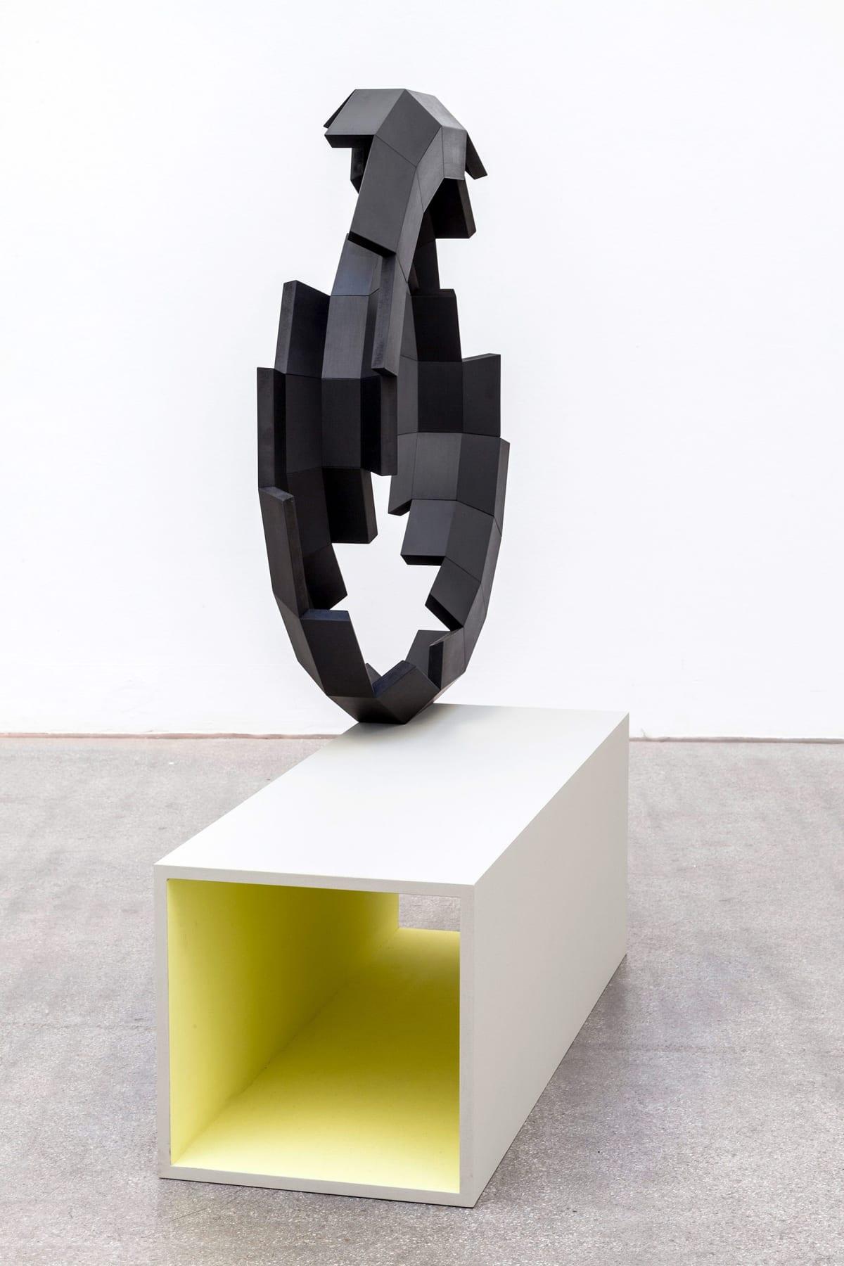 viewing room, art, munchies art club, shows a black sculpture on a white pedestal.