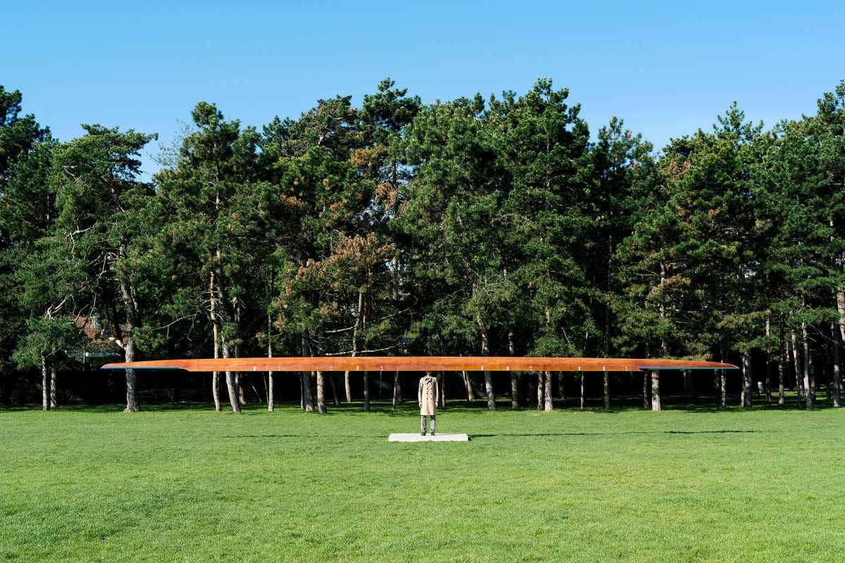 public art, roman pfeffer, viewing room, art, ,outdoor scene in a park of a sculpture of a man without a head and a rowing boat