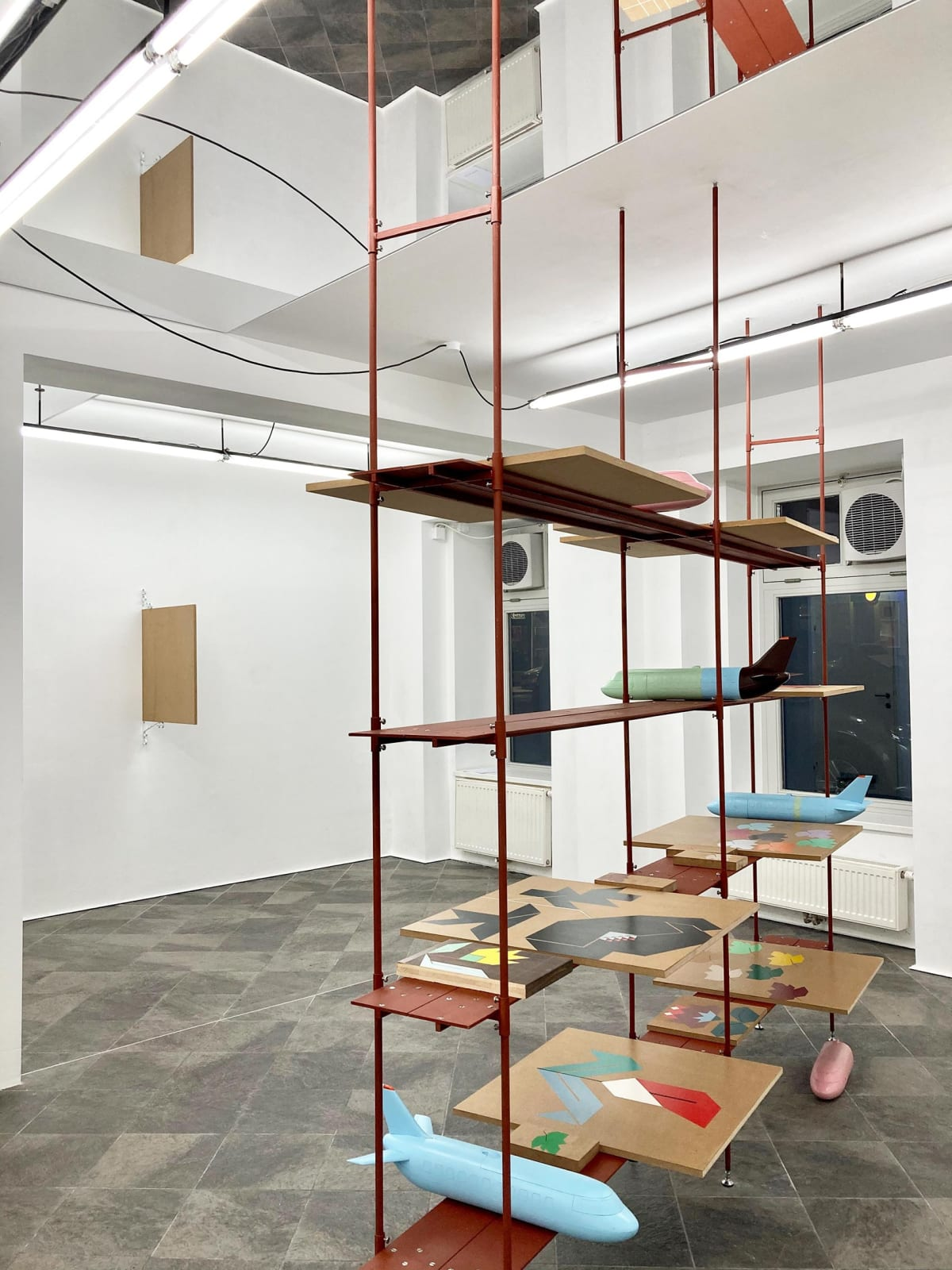 image shows shelves with artwork from the artist Siggi Hofer.