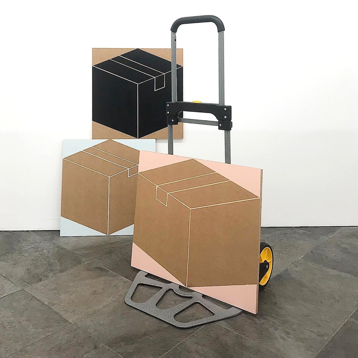 Image shows trolley holding three artworks from contemporary artist Siggi Hofer