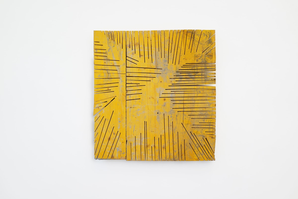 ernst koslitsch artwork depicts a yellow sqare piece of wood with deep cuts in the wood
