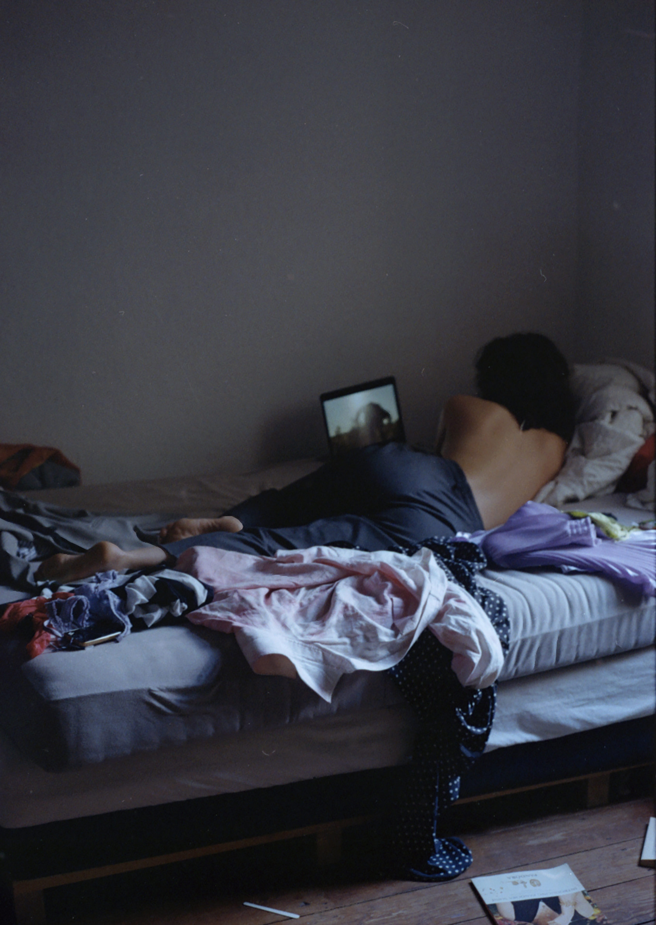 paula hummer, young female photographer, portrait photos, girl on a bed, serene, 35mm,
