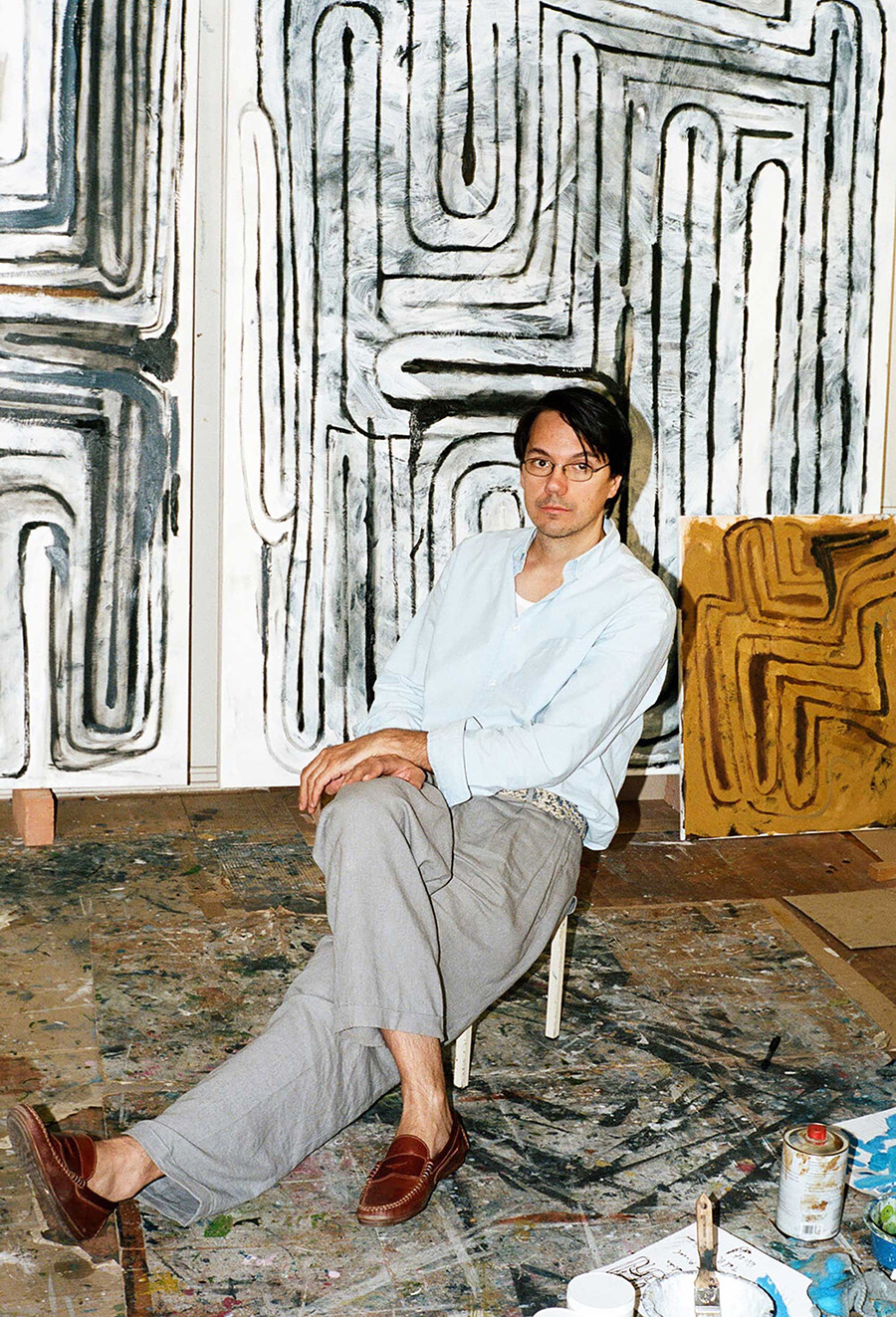 josef zekoff, artist, studio, paintings on wall, portrait