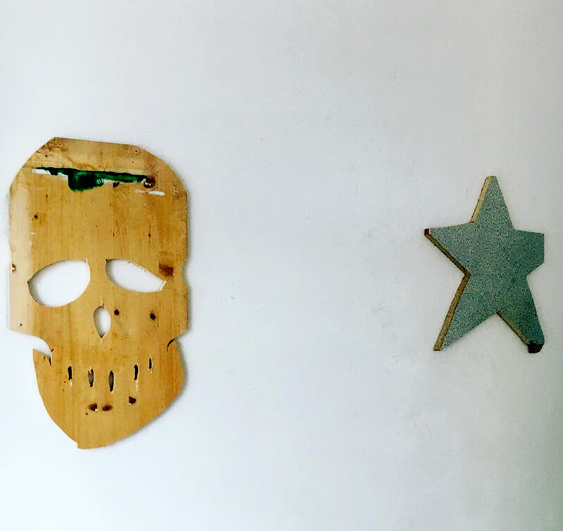 platform, artist to watch portrait , skull, star, wooden objects, wall,