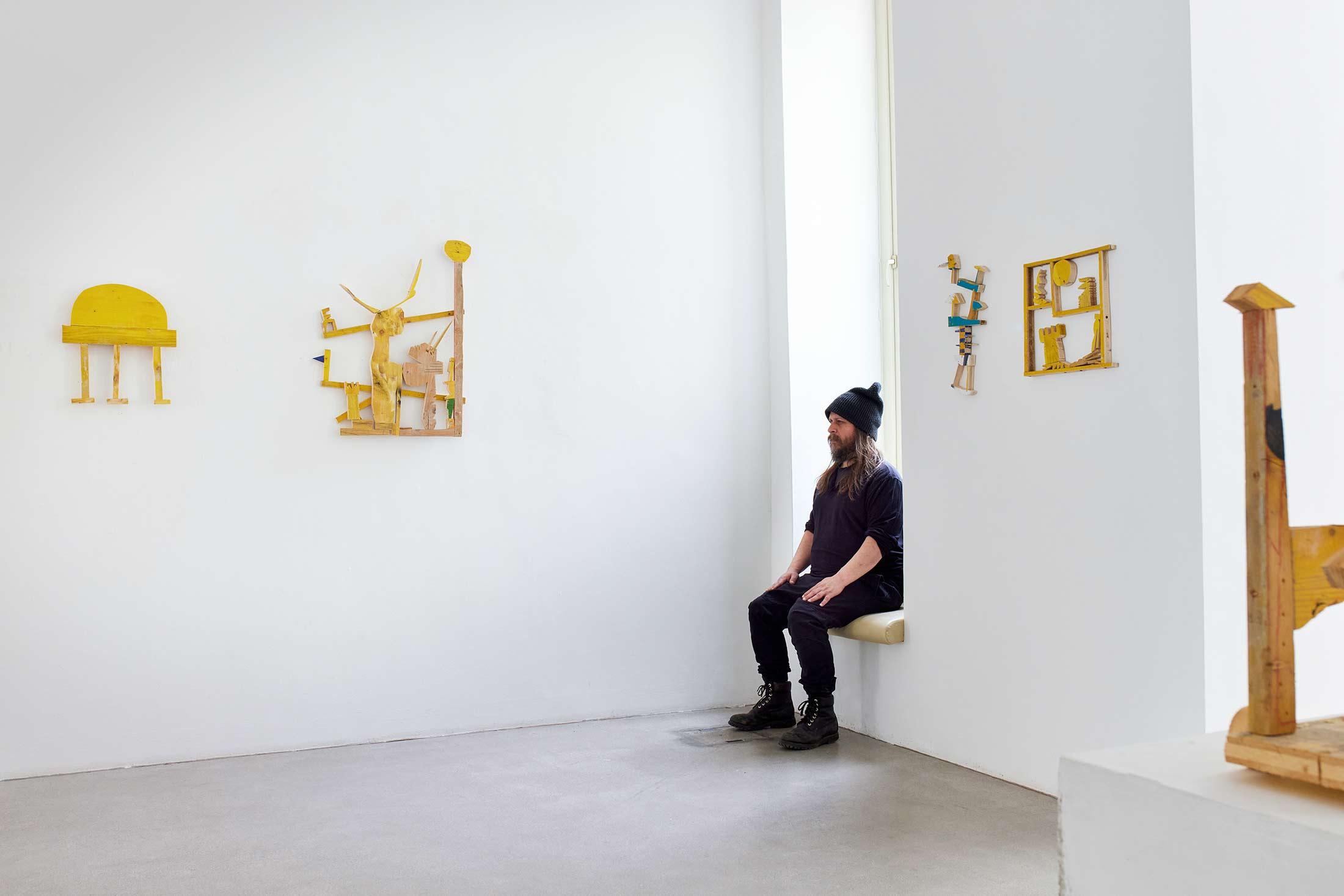exhibition view, ernst koslitsch, art gallery, viewing room, wood sculpture works, yellow universe,