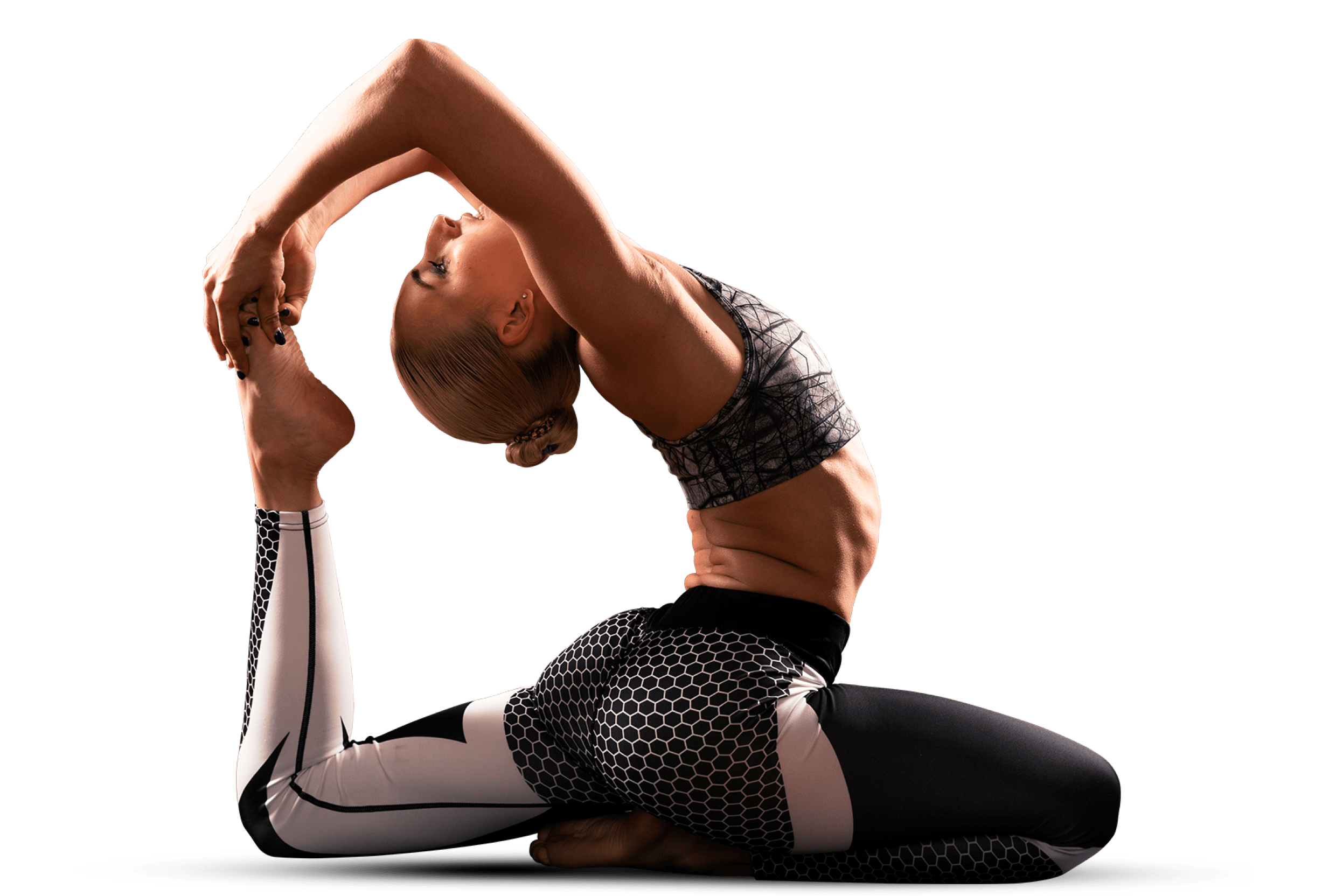 Athletic woman performing a yoga back-bend.