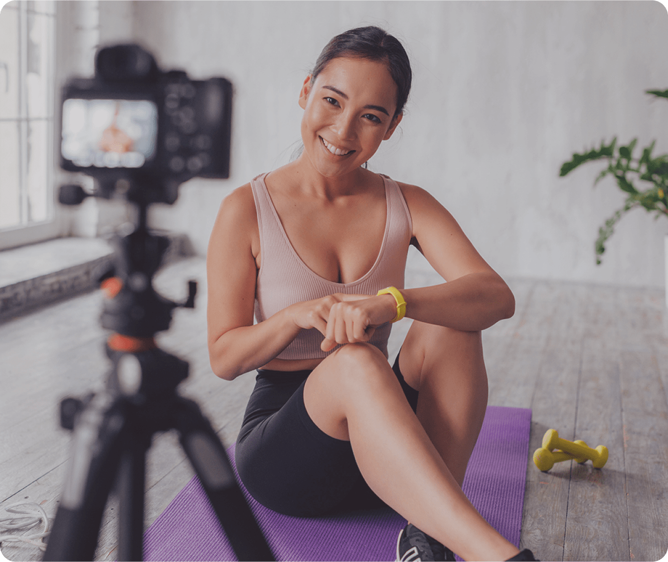 Asian woman live streaming a yoga class