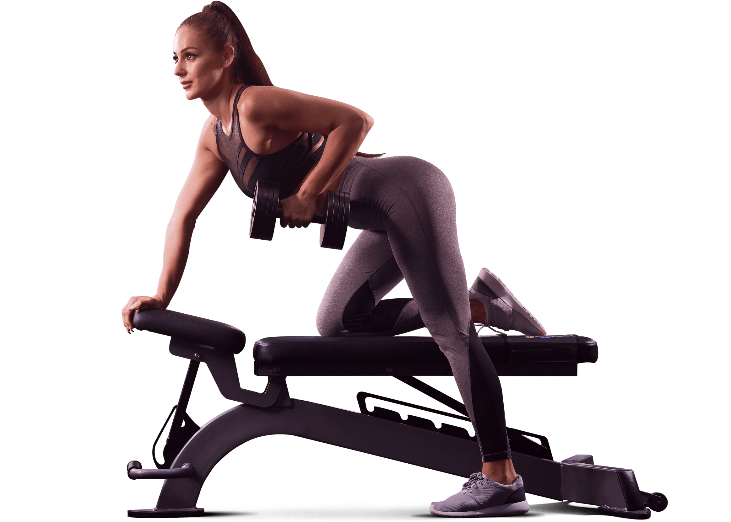Woman performing a dumb-bell exercise at the gym