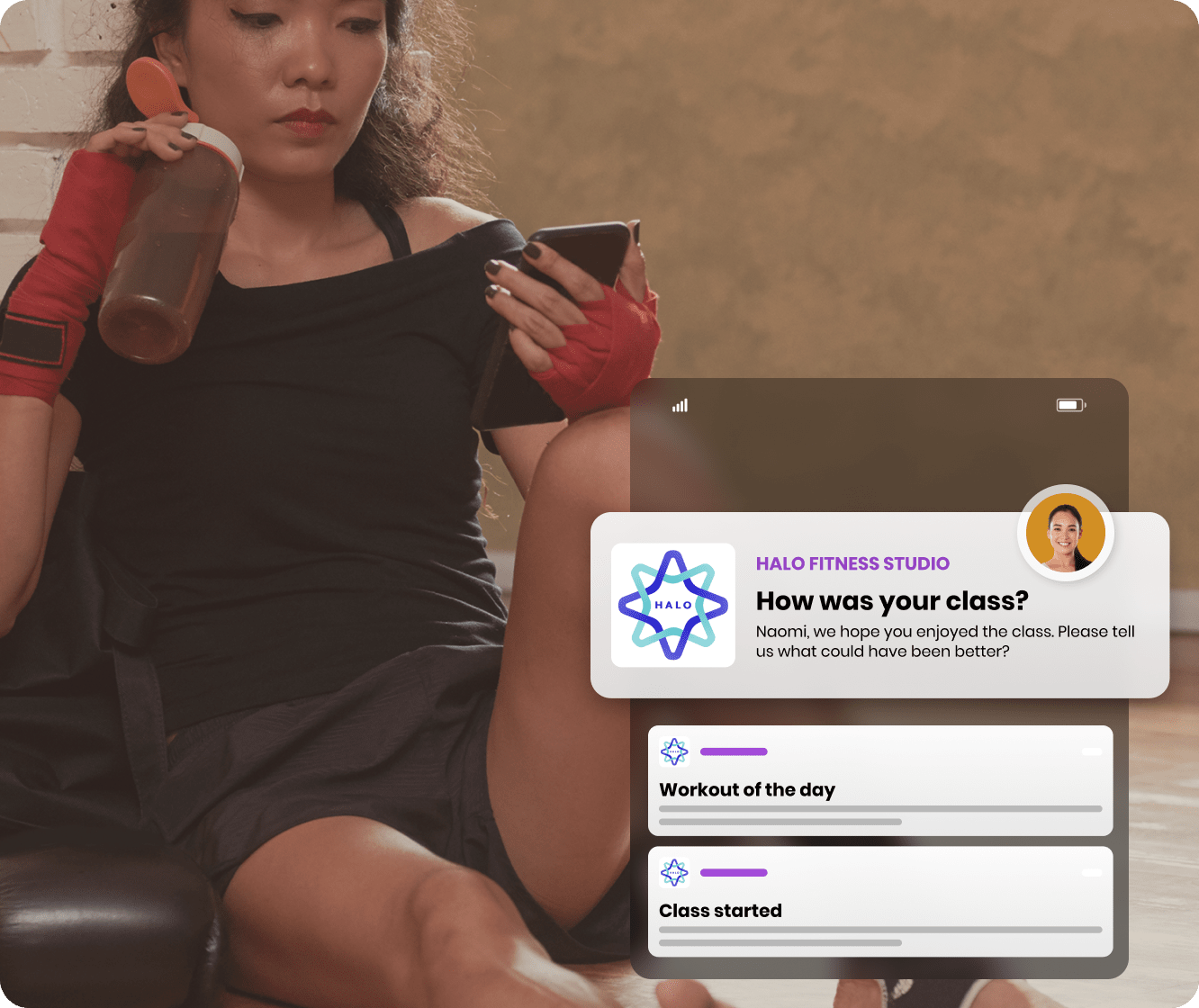 Boxer woman receiving notifications on her phone