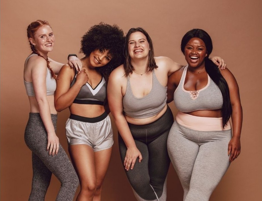 Fitness models of different ethnicities and body sizes.
