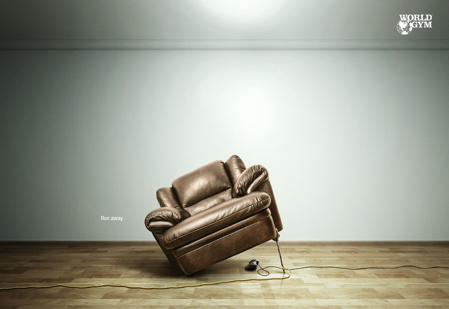A tilted cushion sofa seat with a rope running through its front right leg.