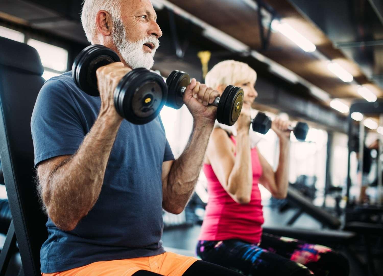 An old man lifting dumbbells