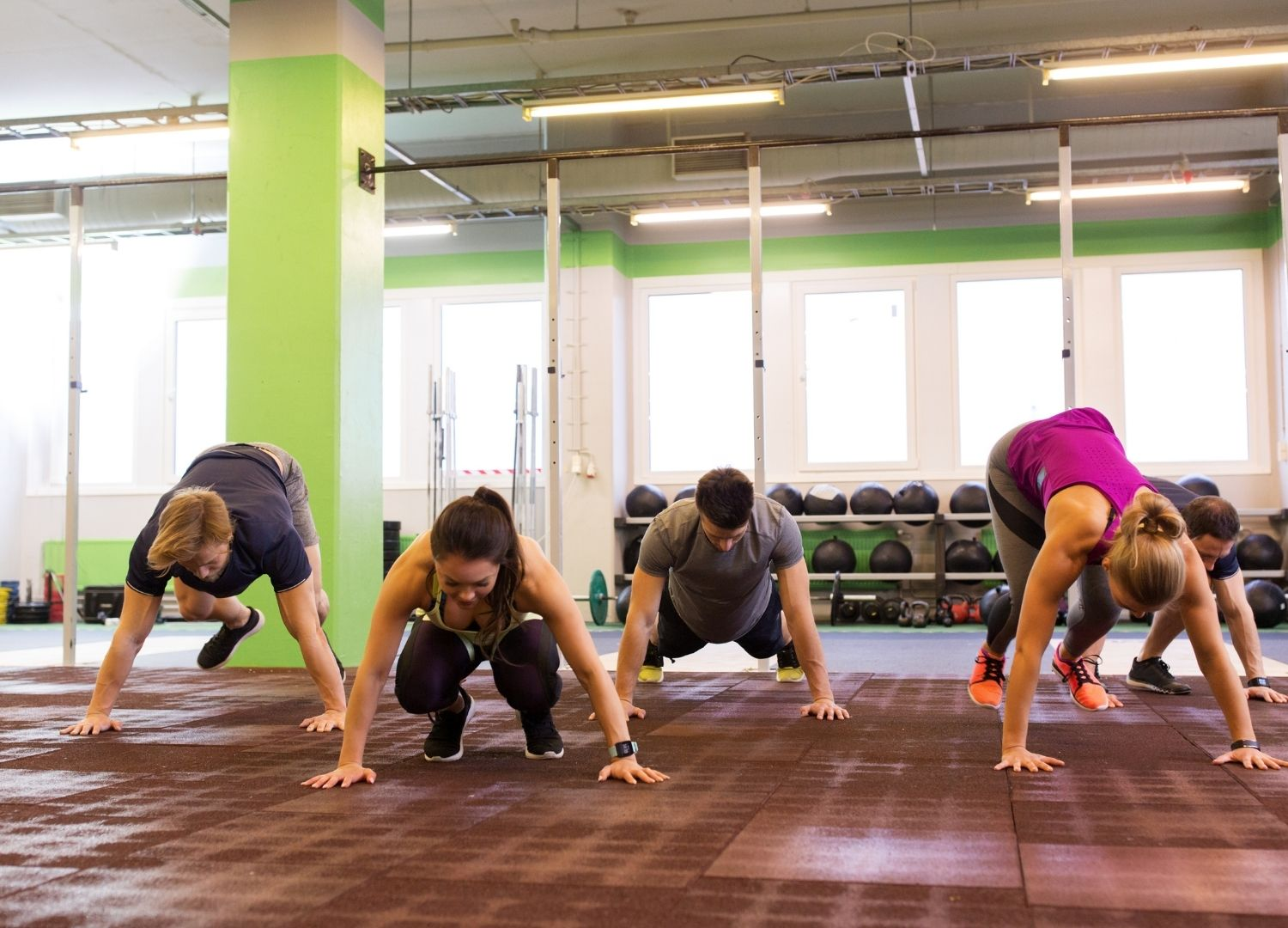 Group of people participating in 1-min burpee challenge