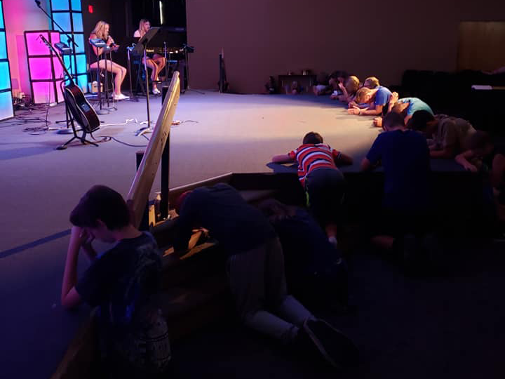 Youth praying at the sanctuary.