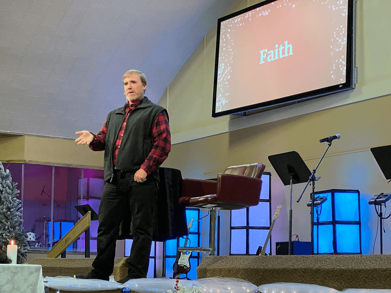 Pastor Scott preaching from the pulpit.