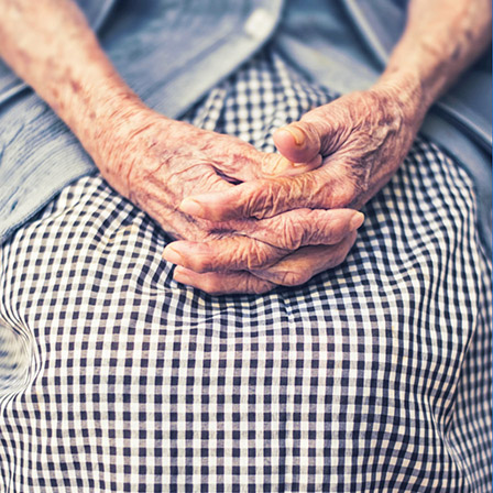 A close-up of the hands of an elderly woman.