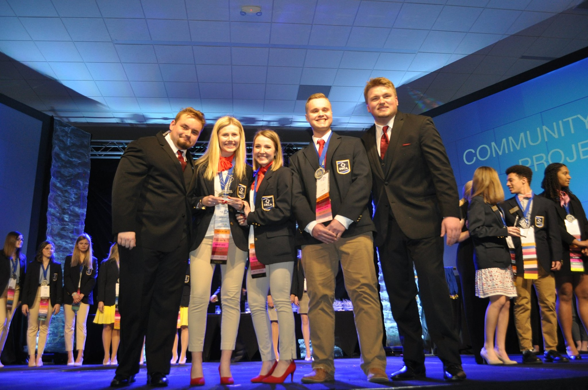Picture of state officers on stage with WI DECA event winners
