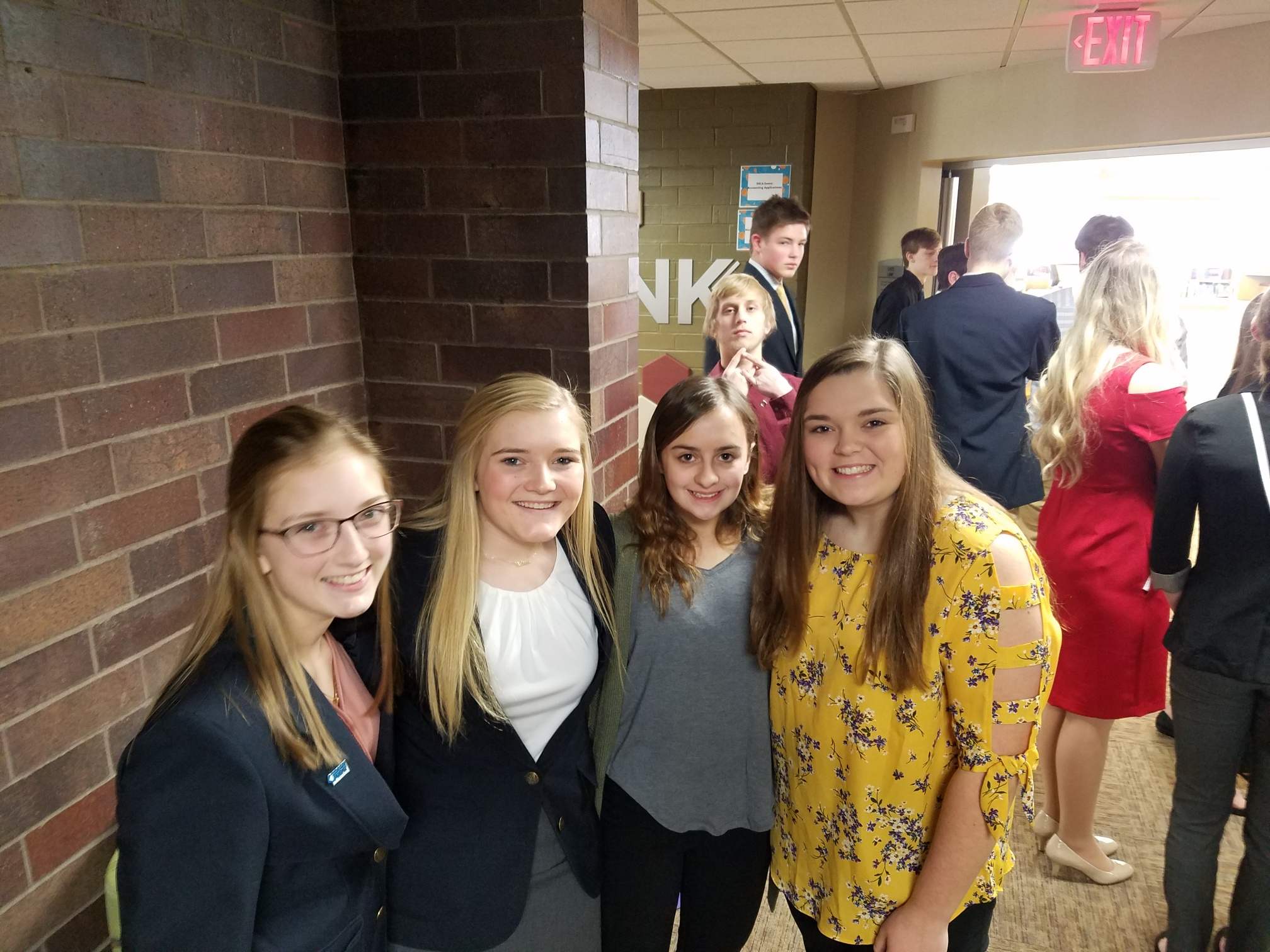 4 Students at WI DECA Districts Conference