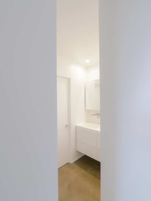 Photo of bathroom with closet door closed