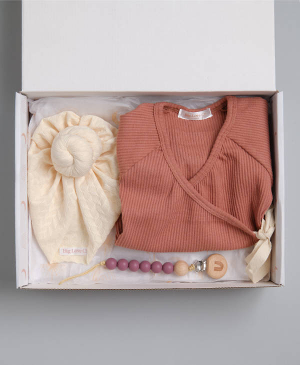 Newborn baby girl gift hamper with ribbed onsie baby romper, cream knot turban and berry baby dummy chain