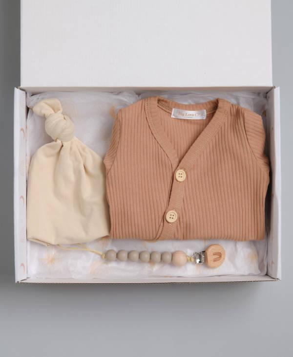 Newborn baby boy gift hamper with ribbed onesie baby romper, cream baby beanie and stone baby dummy chain
