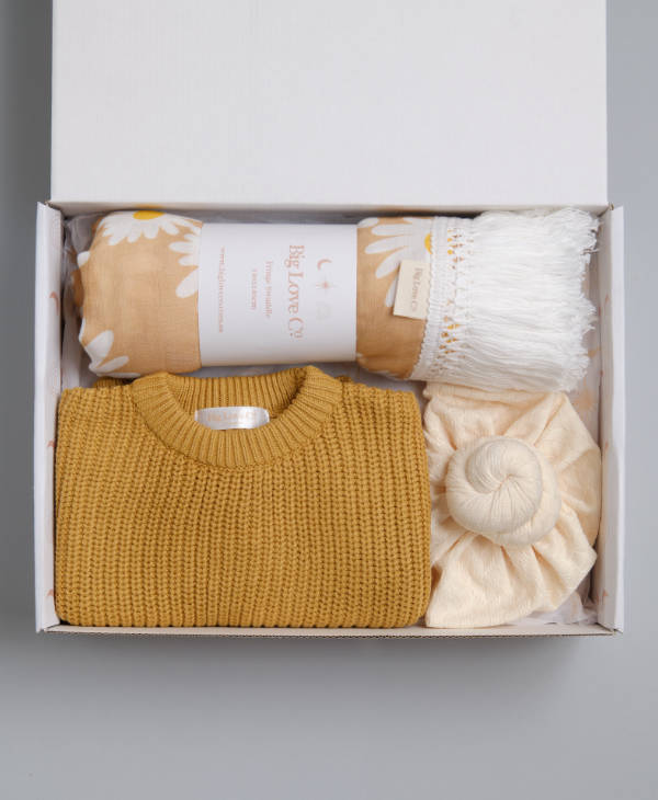 Newborn baby girl gift hamper with mustard oversized knitted baby jumper, cream knot turban and daisy fringe swaddle