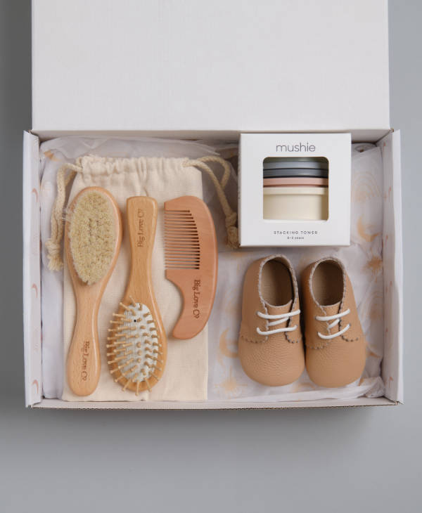 Newborn baby gift box with mushie stacking cups, wooden comb and brush baby grooming set and leather baby shoes