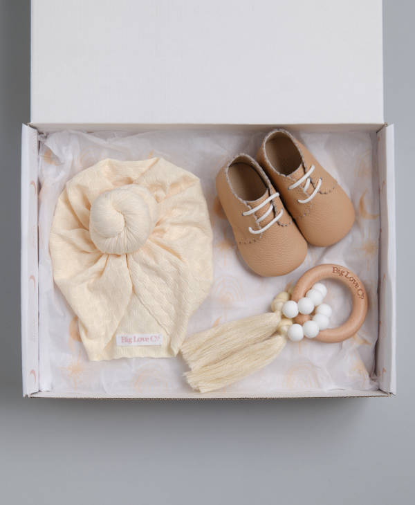 Newborn baby gift hamper with cream knot baby turban, wooden teething ring and leather baby shoes