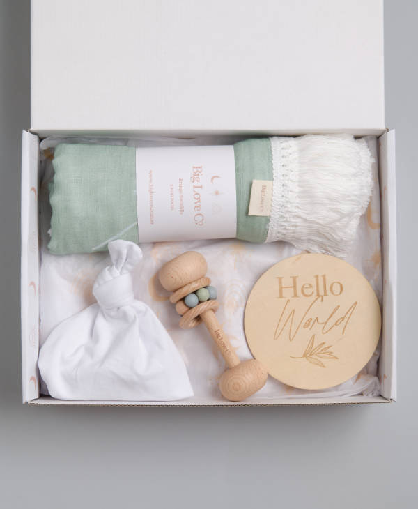 Baby boy gift hamper with sage palm tree fringed swaddle, teething toy, hello world sign and knot beanie