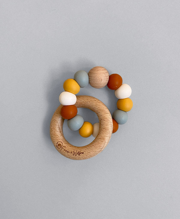 Foxx & Willow's stunning Infinity Teether features the highest quality non-toxic, 100% food grade silicone beads free of BPA, Lead, Phthalates, Cadmium PVC & Latex & completely natural wood beads and an interlocking beech wood ring that is naturally antibacterial and non-splintering.