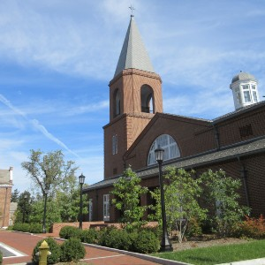 Contemporary brick church building with a simple brick tower on a brick courtyard