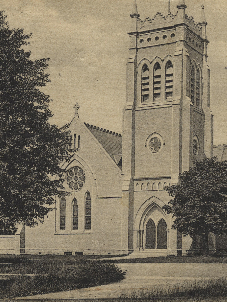 An old monochrome photograph of a gothic revival church