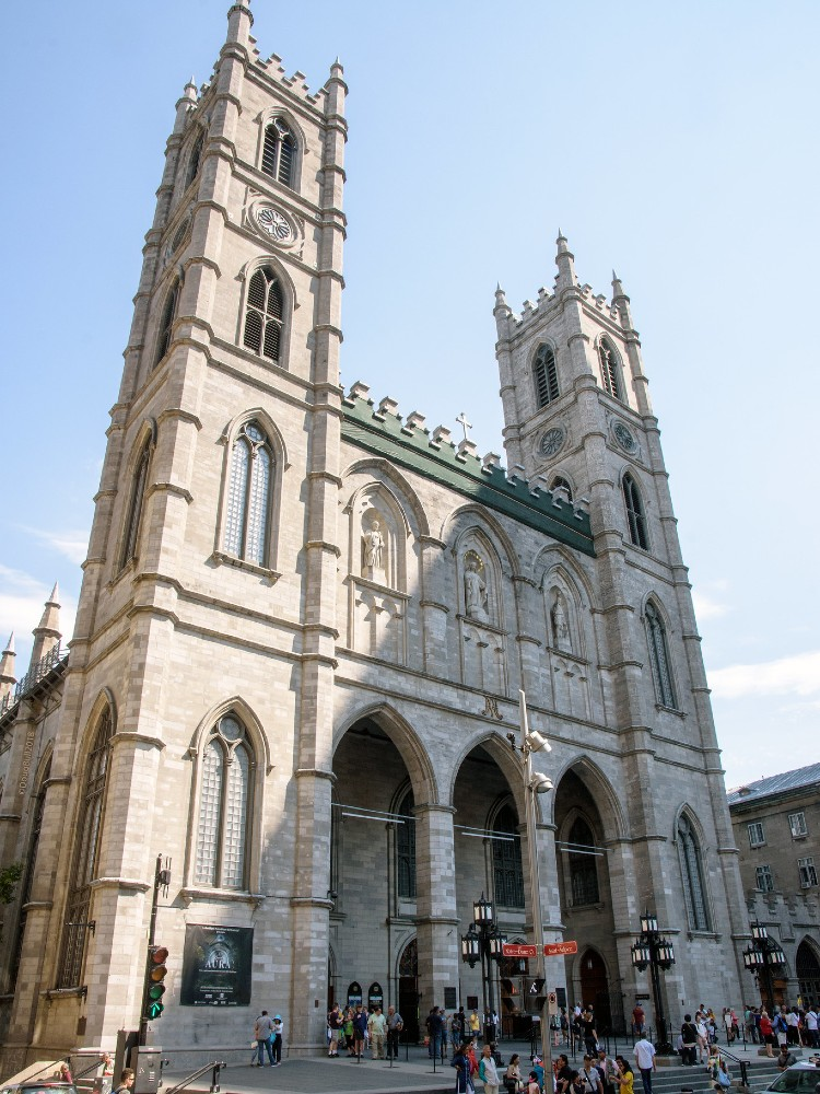 Front facade of a gothic revival cathedral with two towers