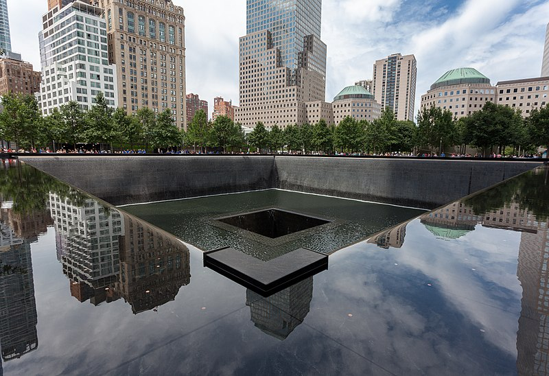The ground zero memorial in New York City, with a serene water feature sunken below ground on the footprint of a fallen tower
