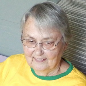 A senior woman with a yellow T-shirt and a nice smile