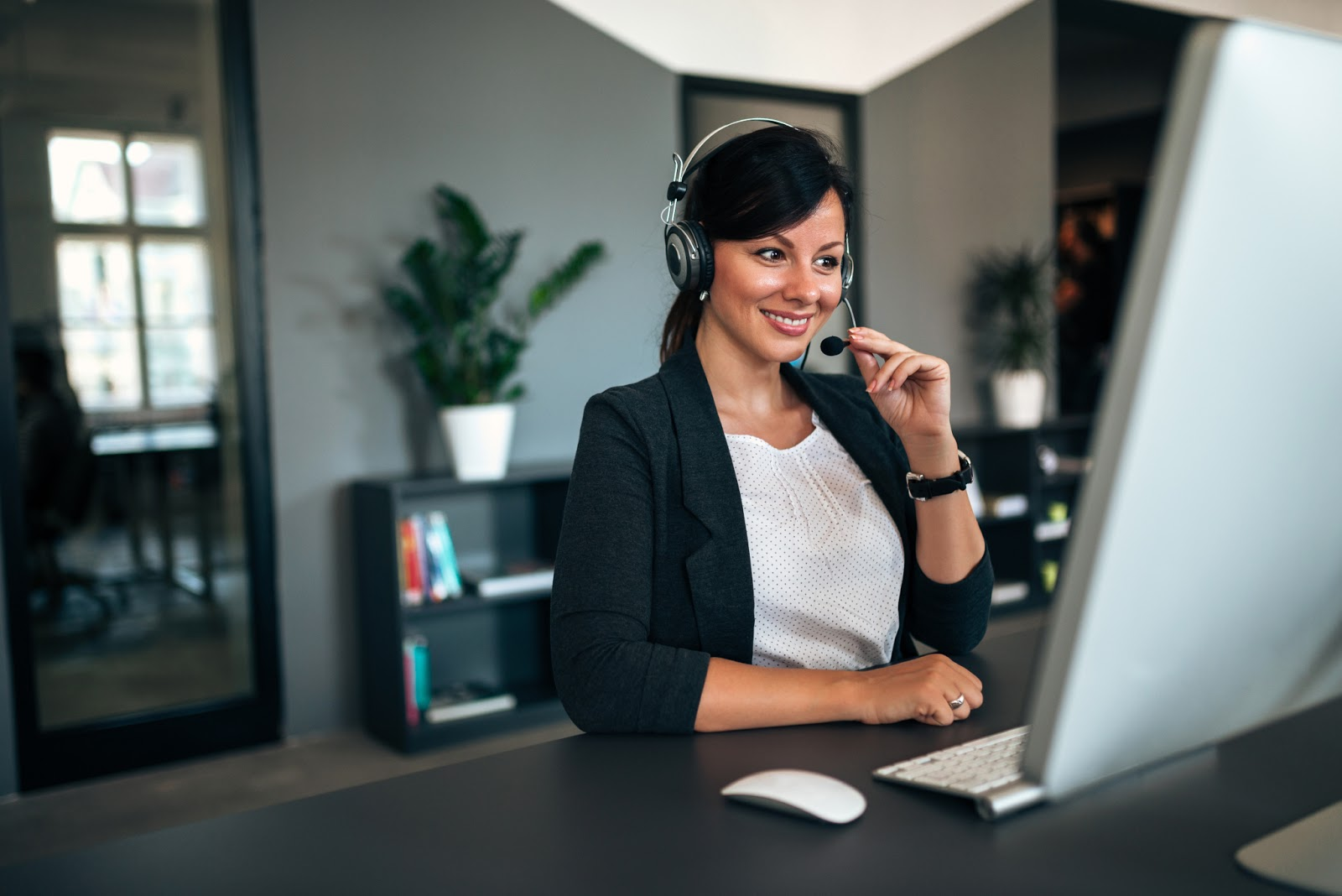 Woman on headset helping with high ticket closing