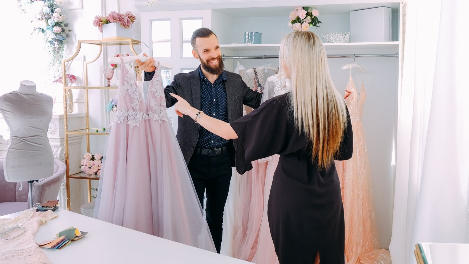 High ticket closing: Man helping woman pick out expensive gown