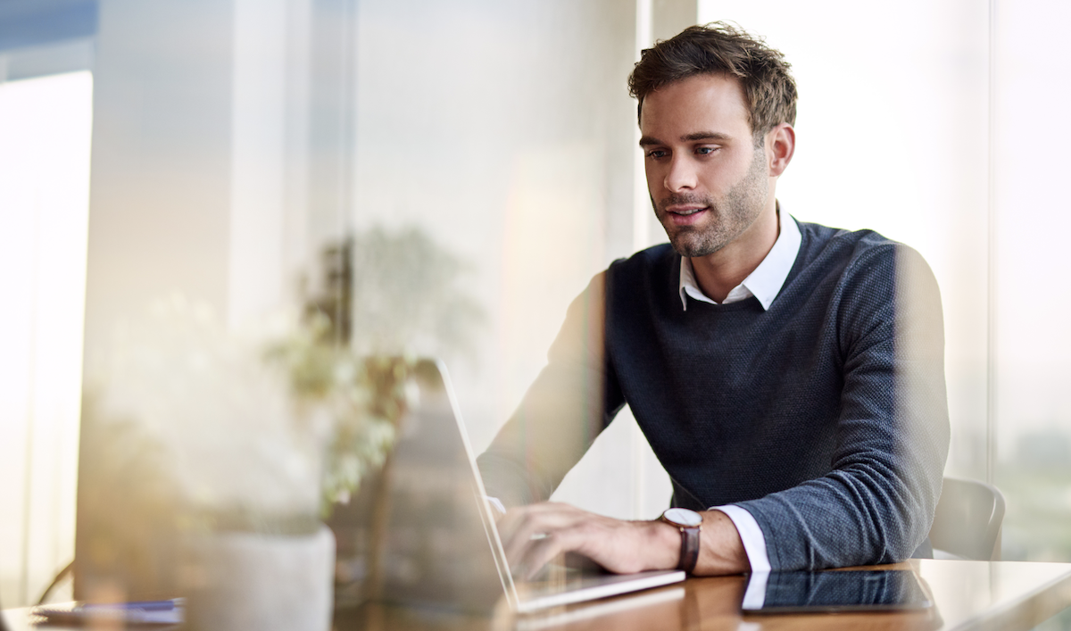 consultative selling: man using a laptop