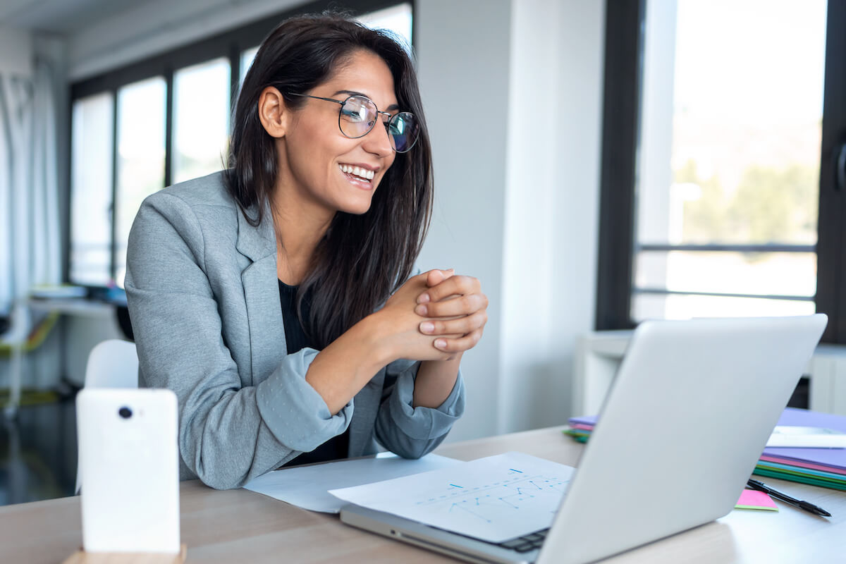 Smiling woman on a video conference