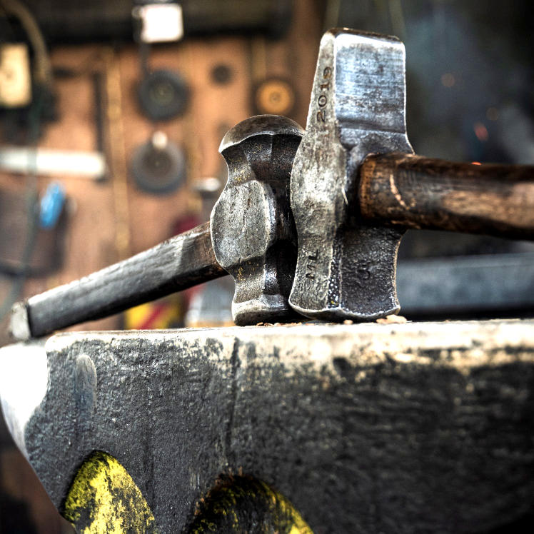 Hammers sit atop anvil
