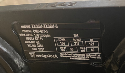 Wedgelock attachment serial number plate