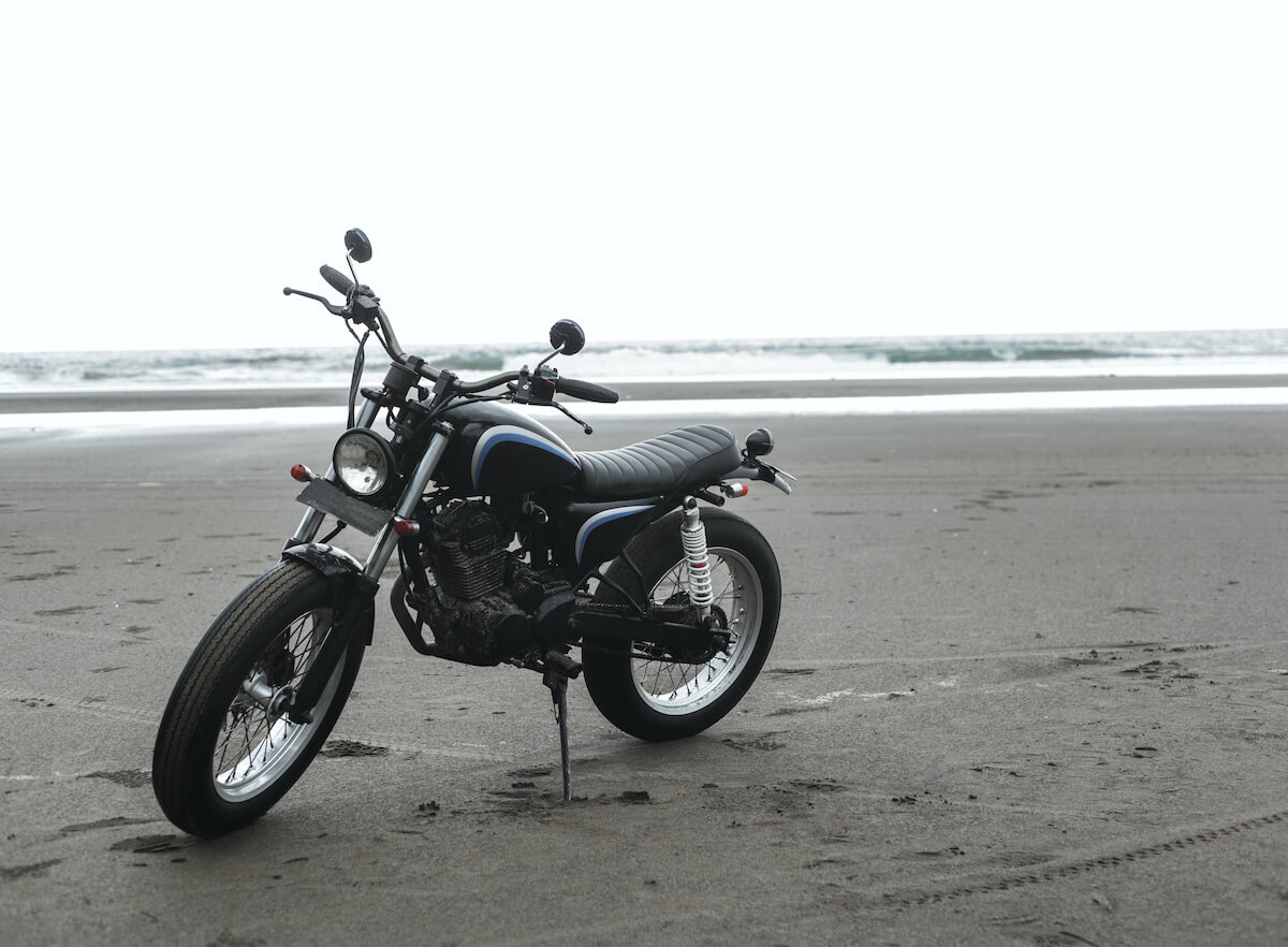 Caferacer motorcycle on a beach