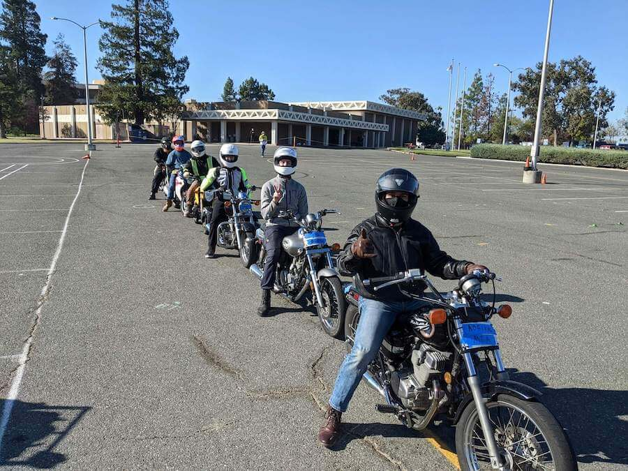 Six student riders on motorcycles during Bay Area motorcycle safety training course.