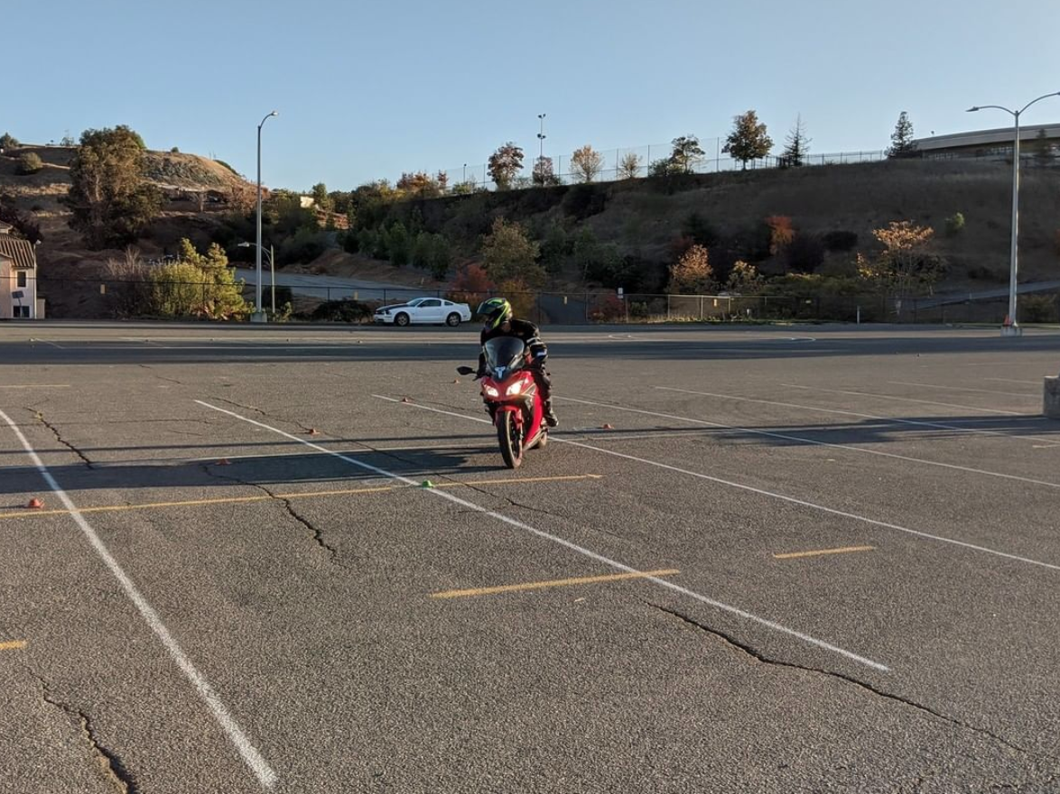Motorcycle student riding in parking lot during class at Golden State Moto