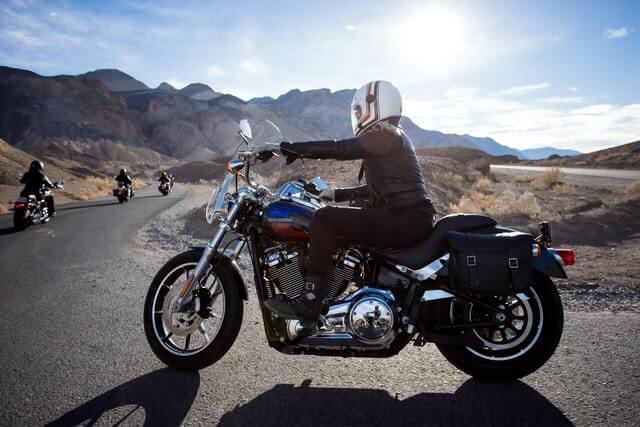 Motorcyclists riding Harley-Davidsons